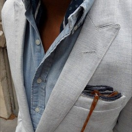 textured blazer, denim shirt, scarf and glasses.