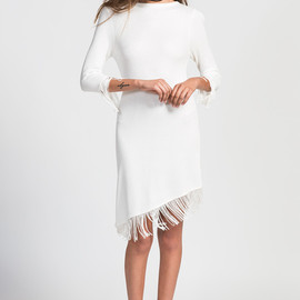 UNIF - white knit dress with fringe detailing and a diagonal hem.