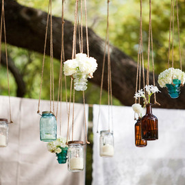 medicine bottles and candles hung over the ceremony site