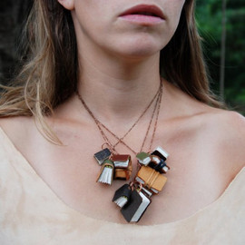 Peg and Awl - Autumnal Library Book Necklace: 11 antique and scrap leather covered books.
