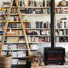 Shelves filled with books and a wood-burning stove