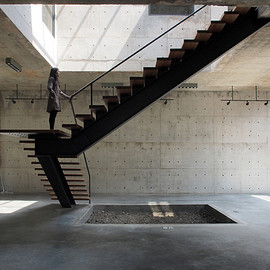architecture firm ASWA - a sculptural floating stairwell