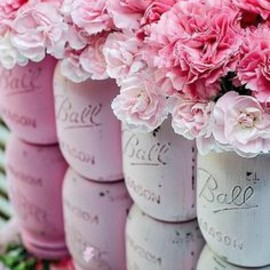 Pink mason jars filled with pink flowers! Perfect decorations or centerpieces for your pink party.