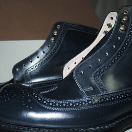 Punched cap toe boots