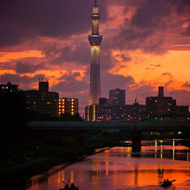 TOKYO SKYTREE and the waterside at twilight.