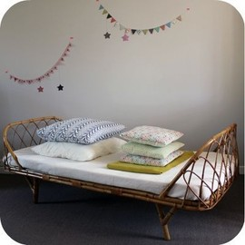 cane daybed L'atelier du Petit Parc...love the garland too