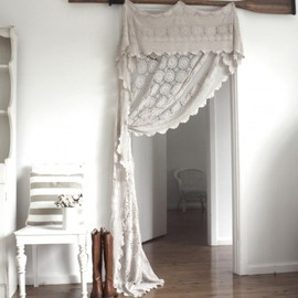 Crocheted curtain + white on white room