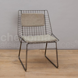 chehoma - Iron chair w/ canvas cushion.