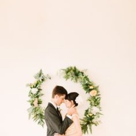 Floral wreath on the wall makes a pretty photo backdrop