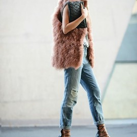 I want this pink fuzzy vest.