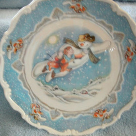 ROYAL DOULTON - SNOWMAN 8INS PLATE WALKING IN THE AIR