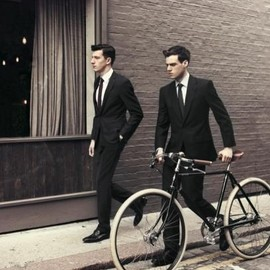 Suits + bicycle.