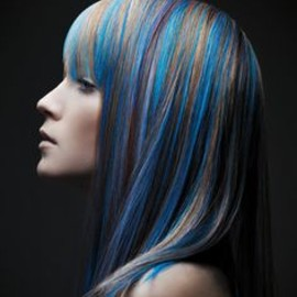 Pop of blue long bob with full bang haircolor