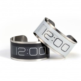 The stylish CST-01 super-thin wristwatch has no buttons and has only one function... to le...