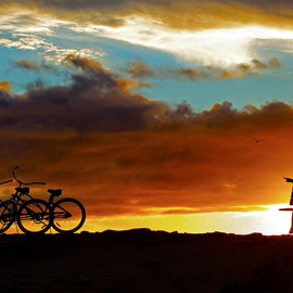 Rich Cruse - A Couple with Two Bikes at Sunset in Dana Point.