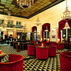 Paris, Rive Gauche, France - Art deco Interior Design with red seats and cool ceiling and floor at Lutetia Bar at the Hotel Lutetia