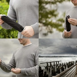 quirky - Overcoat - an umbrella with a waterproof bag to the handle