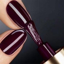 Dark plum nails.