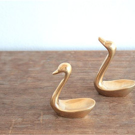 a pair of little brass swans