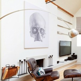 Skull print with Eames Lounge chair.