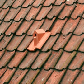 Turn Your Roof into a Bird Sanctuary with Ceramic Birdhouse Roof Tiles by Klaas Kuiken