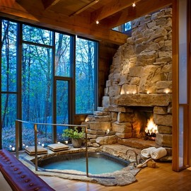Indoor fireplace and hot tub. - Indoor fireplace and hot tub.