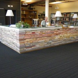 Enormous library desk made of books