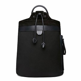 Acne Studios - Trash  A marine inspired canvas backpack with leather insert and drawstring detailing.