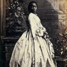 "Lady Sarah Forbes Bonetta Davies, photographed by Camille Silvy, 1862    Sarah Forbes Bonetta Davies was a child born into a royal West African dynasty. She was orphaned in 1848, when her parents were killed in a slave-hunting war. She was around five years old. In 1850, Sarah was taken to England and presented to Queen Victoria as a ""gift"" from the King of Dahomey. She became the queen's goddaughter and a celebrity known for her extraordinary intelligence.  She spent her life between the Bri..."