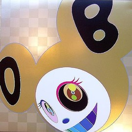 Takashi Murakami and one of his sculptures.