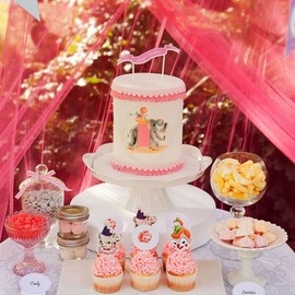A beautiful dessert table in a pink tent!