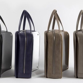Maison Martin Margiela - invites you to discover the ergonomic bags from the Womenswear Autumn-Winter 2013 collection.