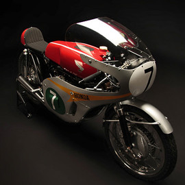 Honda - Honda's Isle of Man TT winning RC166, ridden by Mike Hailwood (UK)