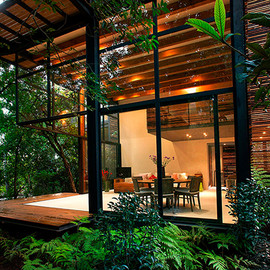 Angle Open Space Private Garden in México Accommodating Four Wooden Houses