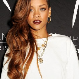 Versace - Rihanna wearing a Versace golden necklace with a gold medusa pendant