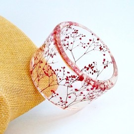 Handmade contemporary jewelry with resin and real...   books, paper, scissors