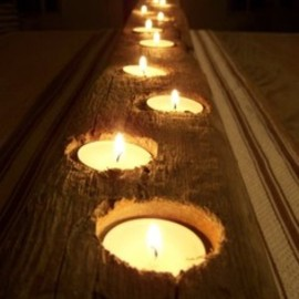 drill holes in wood, place tea lights. center piece for outside table.
