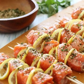 Salmon cubed, and skewered with lemon slices and herbs. Hell yess!