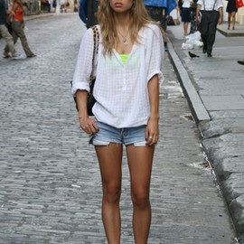 Top, secondhand. Bra, American Apparel. Shorts, vintage Levi's. Studded ankle boots, Colin Stuart. Bag, vintage Chanel.