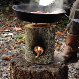 rocket stove made out of wood log! - rocket stove made out of wood log!