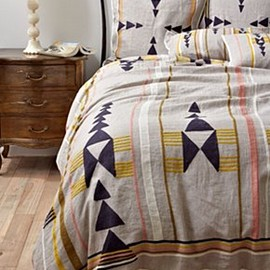 Anthropologie - Neutral linen, striped with arid desert hues and stacked with an abstract arrow motif, was inspired by our buyers' epic road trip through the western USA.