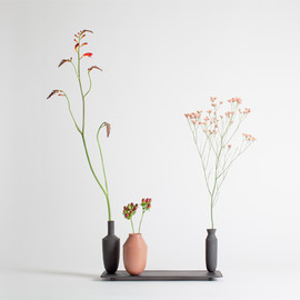 Hallgeir Homstvedt - TANGENT -- A series of cast iron trays and porcelain vases