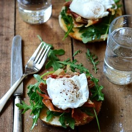 Toasted bagel Breakfast Sandwich with Prosciutto and Egg