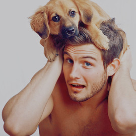 A hot guy holding an adorable puppy!