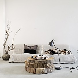 Ollson & Jensen - idea to use three pieces of wooden trunks for a coffee table.