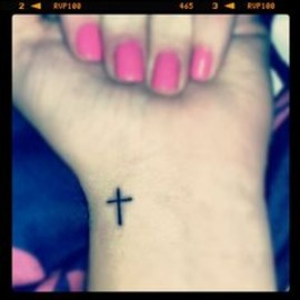 tattoos - wrist cross tattoo.. I want a different tattoo, but in the same placement