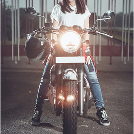 Kawasaki - This is Chips Jing on her Kawasaki W400. She represents the rare few lady riders in the custom