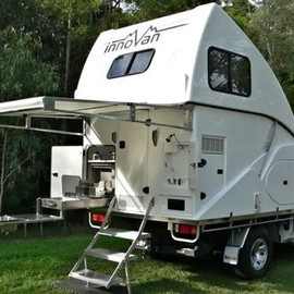 Brute with Four Wheel Campers pop-up. Both are custom made - Brute with Four Wheel Campers pop-up. Both are custom made