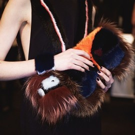 Fendi - monster face fur clutch