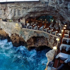 Polignano a mare, Italy - Oceanside restaurant built into a grotto